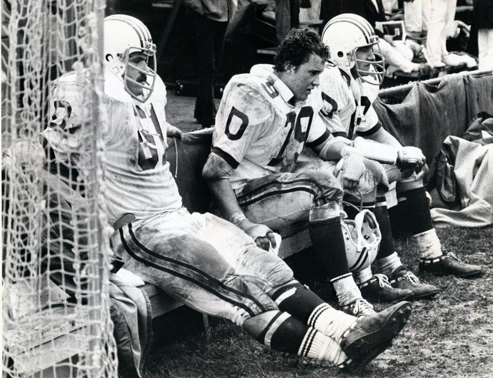 Dartmouth College offensive lineman Jeff Immelt, center, wore a pained expression in the fourth quarter against Harvard in 1977.